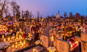 All Saints'Day at a cemetery in Gniezno, Poland – flowers and candles placed to honor deceased relatives